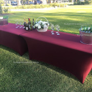 Trestle Tables decorated with burgundy cloth